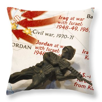 Army Man Lying On Middle East Conflicts Map Throw Pillow by Amy Cicconi
