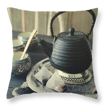 Throw Pillow featuring the photograph Asian Teapot With Cups And Herbal Bags Of Tea by Sandra Cunningham