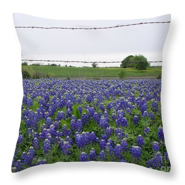 Throw Pillow featuring the photograph Barbed Wire Bluebonnets by Jerry Bunger