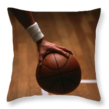 Basketball Ball In Male Hands Throw Pillow by Lanjee Chee