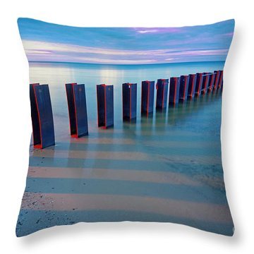 Beach Pylons At Sunset Throw Pillow by Martin Konopacki