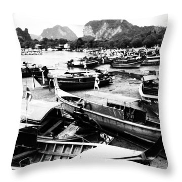 Beached Longboats Throw Pillow by Justin Woodhouse
