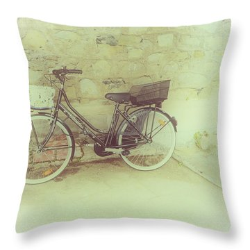 Bicycle Against Stone Wall Throw Pillow