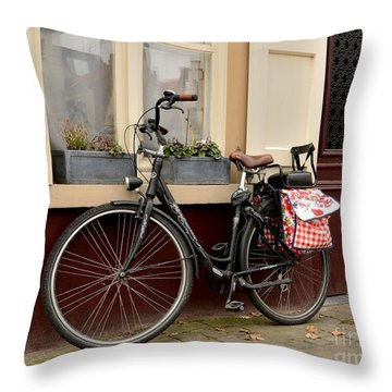 Bicycle With Baby Seat At Doorway Bruges Belgium Throw Pillow by Imran Ahmed