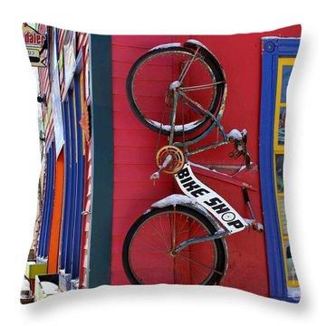 Bike Shop Throw Pillow by Fiona Kennard