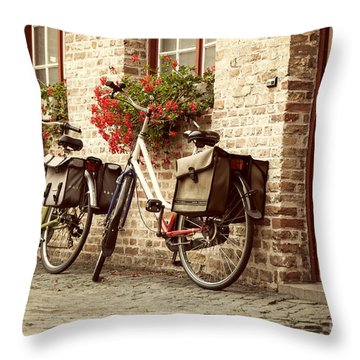 Bikes In The School Yard Throw Pillow by Juli Scalzi