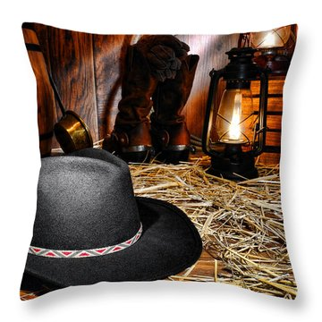 Black Cowboy Hat In An Old Barn Throw Pillow by Olivier Le Queinec