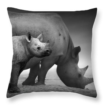 Black Rhinoceros Baby And Cow Throw Pillow by Johan Swanepoel