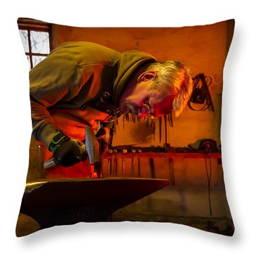 Blacksmith In Torresta Throw Pillow by Torbjorn Swenelius