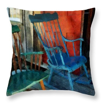 Blue Chair Against Red Door Throw Pillow by Susan Savad