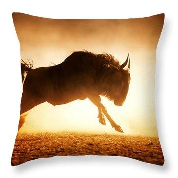 Blue Wildebeest Running In Dust Throw Pillow by Johan Swanepoel