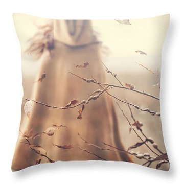 Throw Pillow featuring the photograph Blurred Image Of A Woman With Cape by Sandra Cunningham