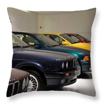 Bmw Cars Through The Years Munich Germany Throw Pillow by Imran Ahmed