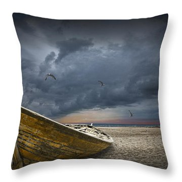 Boat With Gulls On The Beach With Oncoming Storm Throw Pillow