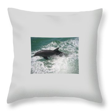 Throw Pillow featuring the photograph Bottlenose Dolphin Catching A Wave by Jean Marie Maggi