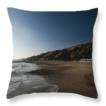 Bournemouth Beach Huts Throw Pillow by Anne Gilbert