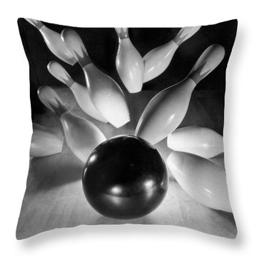 Bowling Ball Strikes Pins Throw Pillow by Underwood Archives