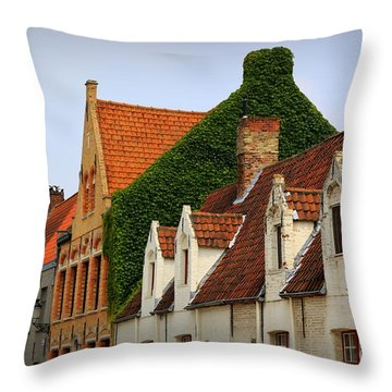Bruges Rooftops Throw Pillow by Carol Groenen