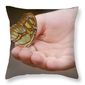 Throw Pillow featuring the photograph Butterfly On Hand by Leticia Latocki