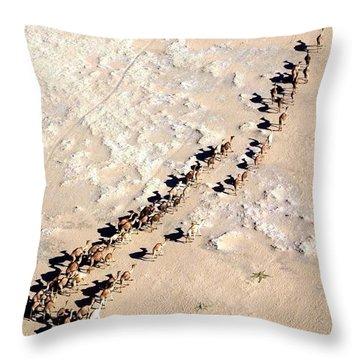 Camels Walking In Desert Throw Pillow