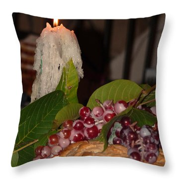Throw Pillow featuring the photograph Candle And Grapes by Marcia Socolik