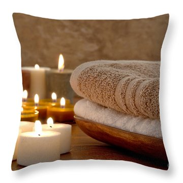 Candles And Towels In A Spa Throw Pillow by Olivier Le Queinec