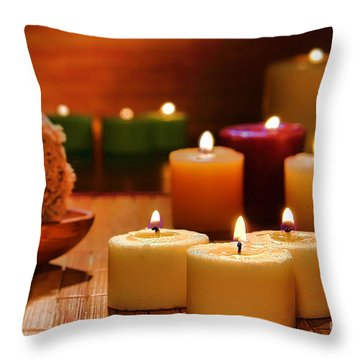 Candles Burning In A Spa  Throw Pillow by Olivier Le Queinec