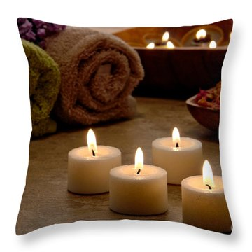 Candles In A Spa Throw Pillow by Olivier Le Queinec