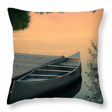 Canoe At A Dock At Sunset Throw Pillow by Jill Battaglia