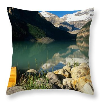 Canoe At The Lakeside, Lake Louise Throw Pillow by Panoramic Images