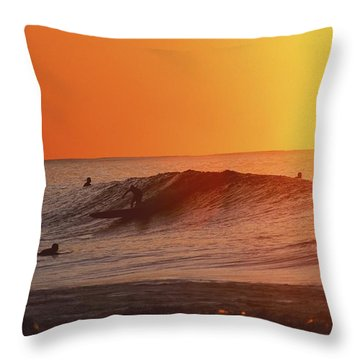 Catching A Wave At Sunset Throw Pillow by Vince Cavataio - Printscapes