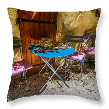 Throw Pillow featuring the photograph On The Patio by Dany Lison