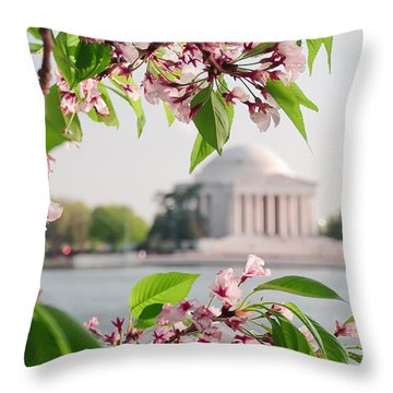 Throw Pillow featuring the photograph Cherry Blossoms And The Jefferson Memorial by Mitchell R Grosky