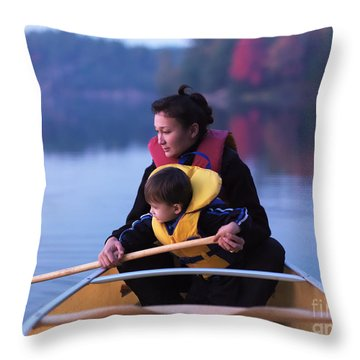 Child Learning To Paddle Canoe Throw Pillow by Oleksiy Maksymenko