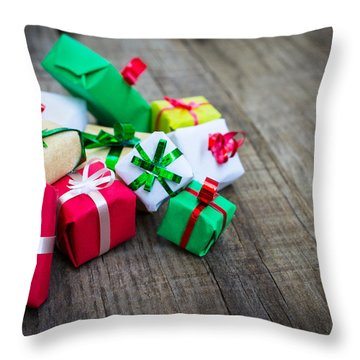 Christmas Gifts Throw Pillow by Aged Pixel