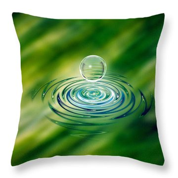 Clear Bubble Rising From Ripples Throw Pillow