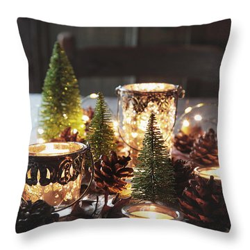 Throw Pillow featuring the photograph Closeup Of Candles And Decorations For The Holidays by Sandra Cunningham