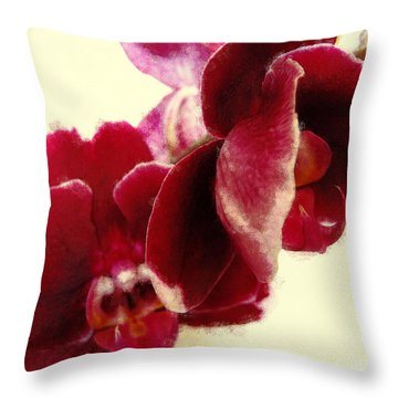 Closeup Of Flowering Burgundy Orchid Throw Pillow