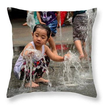 Clothed Children Play At Water Fountain Throw Pillow