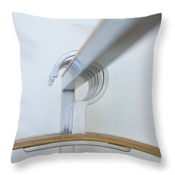 Clothes Hangers Throw Pillow by Mats Silvan