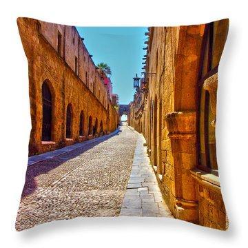 Rhodes Cobbled Street Throw Pillow by Scott Carruthers