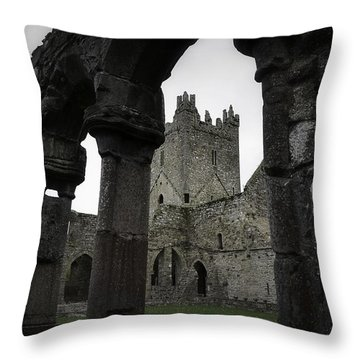 Colonnade And Tower Of Jerpoint Abbey Throw Pillow by Nadalyn Larsen