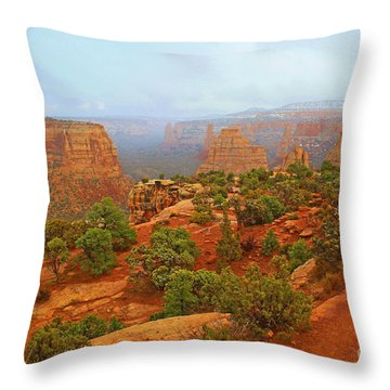 Colorado Natl Monument Snow Coming Down The Canyon Throw Pillow