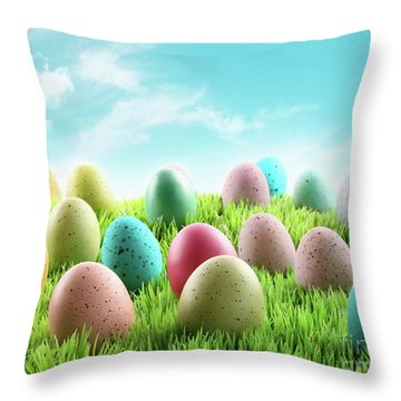 Colorful Easter Eggs In A Field Of Grass Throw Pillow by Sandra Cunningham