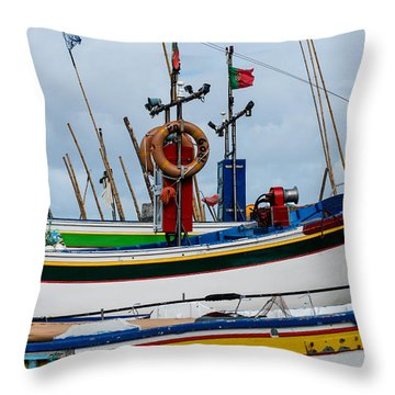 colorful fishing boat with Portuguese flag  Throw Pillow