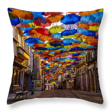 Colorful Floating Umbrellas Throw Pillow