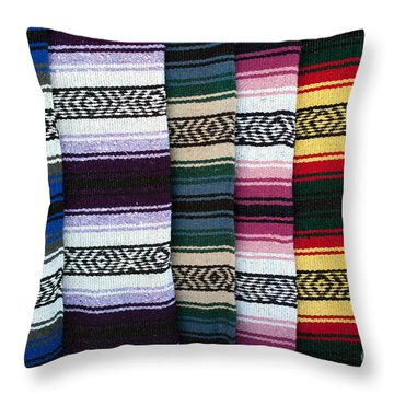 Throw Pillow featuring the photograph Colorful Indian Rug Display by Gunter Nezhoda