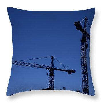 Construction Cranes At Dusk Throw Pillow by Antony McAulay