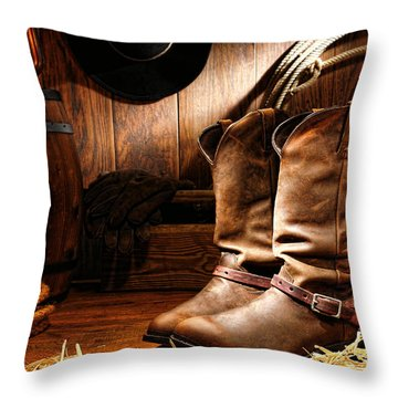 Throw Pillow featuring the photograph Cowboy Boots In A Ranch Barn by Olivier Le Queinec