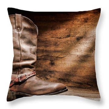 Cowboy Boots On Wood Floor Throw Pillow by Olivier Le Queinec